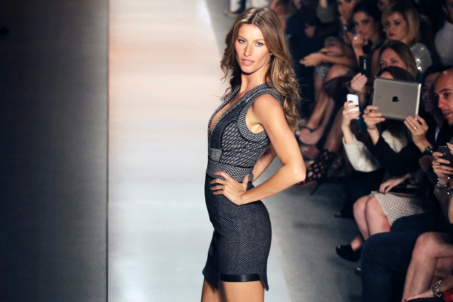 Brazilian model Gisele Bundchen presents a creation from Colcci Winter 2014 collection during Sao Paulo Fashion Week